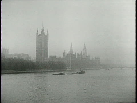 aerial view of london and bomber planes flying / shot of pilots from inside plane / bombs over london / building on fire / bombs exploding / aerial... - 1940 stock videos & royalty-free footage