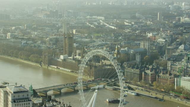 vídeos de stock, filmes e b-roll de aerial view of london eye in capital city - edifício do parlamento