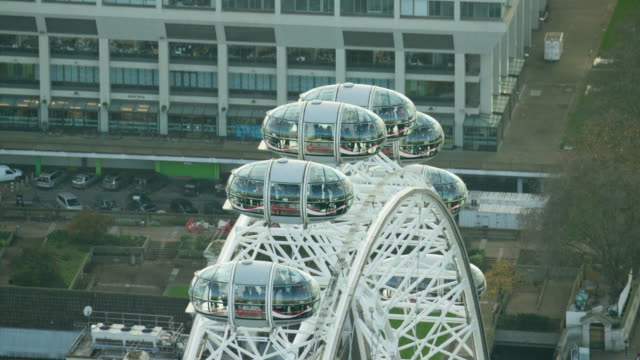 aerial view of london eye in capital city - millennium wheel stock videos & royalty-free footage