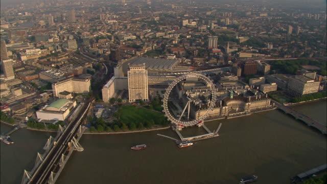 stockvideo's en b-roll-footage met aerial view of london eye on bank of thames / london - 2005
