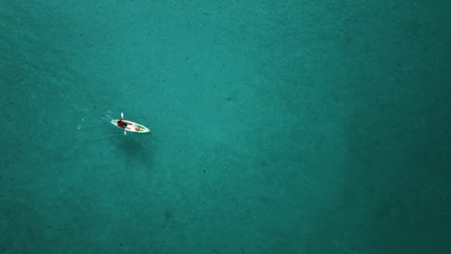 Aerial view of lonely canoe in sea at Thailand.