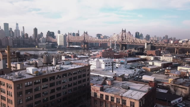 aerial view of long island city, queens - queens new york city stock videos & royalty-free footage