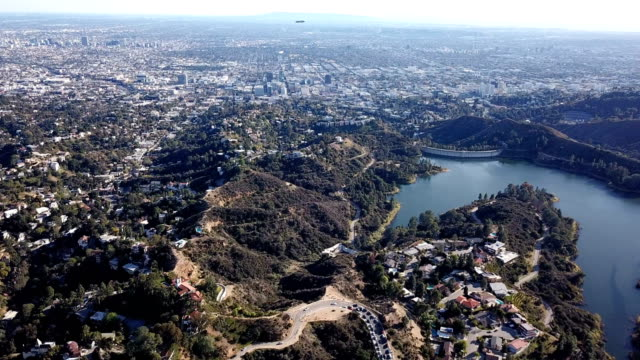 aerial view of los angeles and hollywood mountains - hollywood california stock videos and b-roll footage