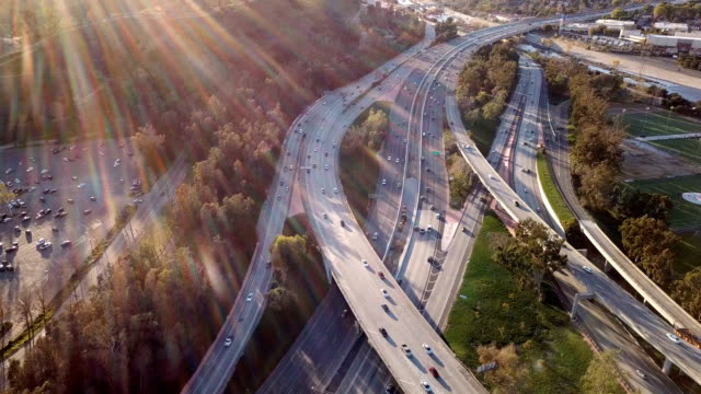 aerial view of los angeles freeway and glendale - hollywood sign stock videos & royalty-free footage