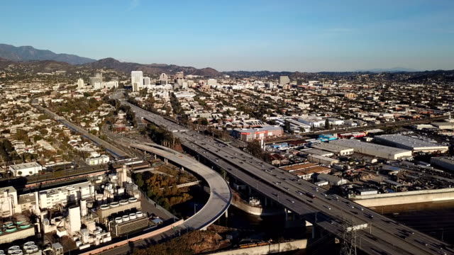 aerial view of los angeles freeway and glendale with power plant - glendale california stock videos & royalty-free footage
