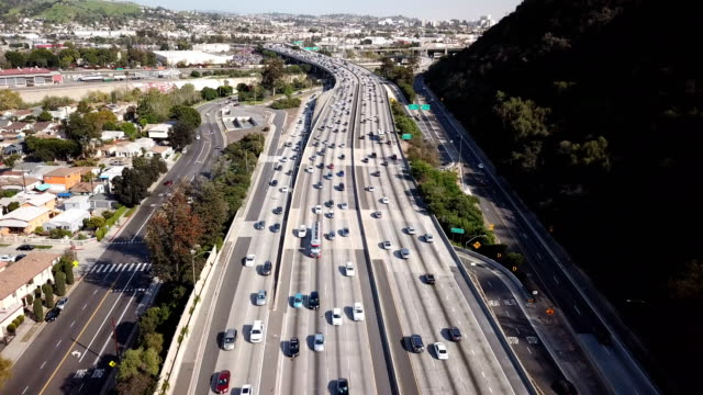 4k aerial view of los angeles freeway and traffic - multiple lane highway stock videos & royalty-free footage