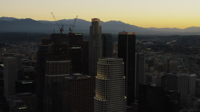 aerial view of los angeles skyline at sunrise - financial building stock videos & royalty-free footage