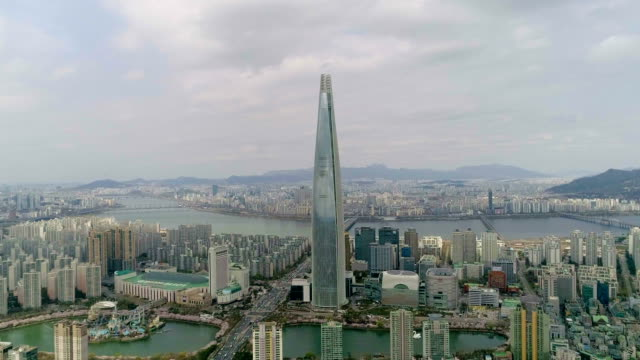 Aerial view of Lotte World Tower (One of the tallest buildings in Korea) and Lotte World amusement park in Spring