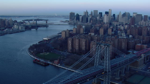 aerial view of lower east side manhattan at dawn with the williamsburg bridge. - williamsburg bridge stock videos and b-roll footage