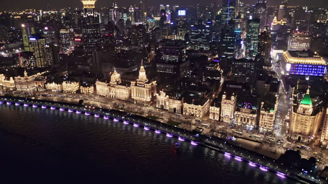 aerial view of lujiazui financial district at night - 上海環球金融中心点の映像素材/bロール