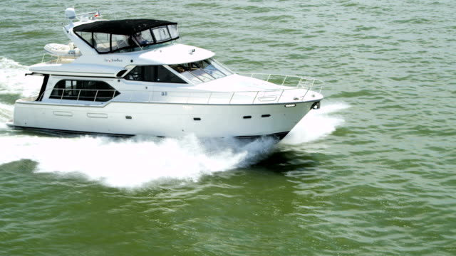 aerial view of luxury motor cruiser pacific ocean - motorboot stock-videos und b-roll-filmmaterial