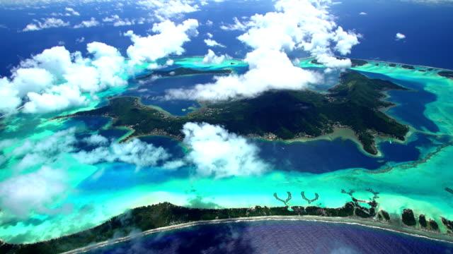 aerial view of luxury vacation resorts bora bora - tahiti stock videos & royalty-free footage