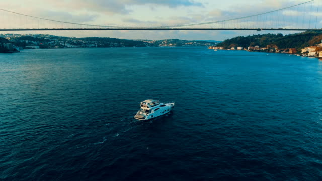 aerial view of luxury yacht on bosphorus, marmara sea istanbul - july 15 martyrs' bridge stock videos & royalty-free footage