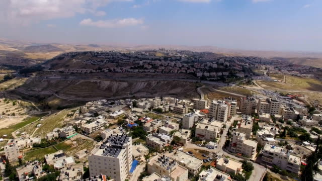 aerial view of ma'ale adumim- an urban israeli settlement and a city in the west bank, seven kilometres from jerusalem, next to arab settlements in the west bank- eizariya, jahalin, abu dis, alshaykh, wadi qadum, altur - west bank stock videos & royalty-free footage