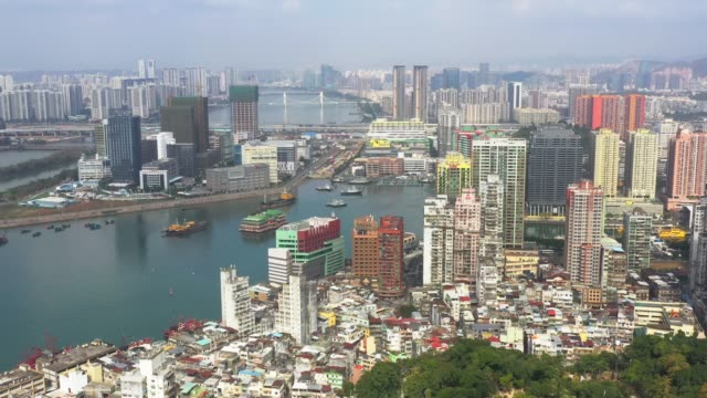 aerial view of macau over the city during day time. travel destination and tourist attractions - macao flag stock videos & royalty-free footage