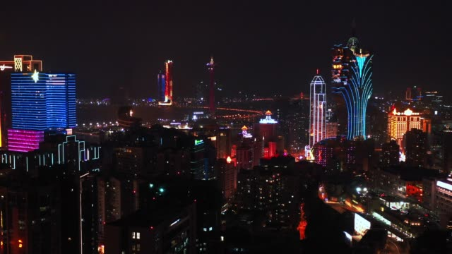 aerial view of macau over the city during night time. travel destination and tourist attractions - macao stock videos & royalty-free footage