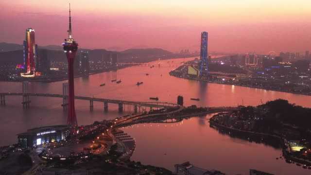 aerial view of macau over the city during night time. travel destination and tourist attractions - macao flag stock videos & royalty-free footage