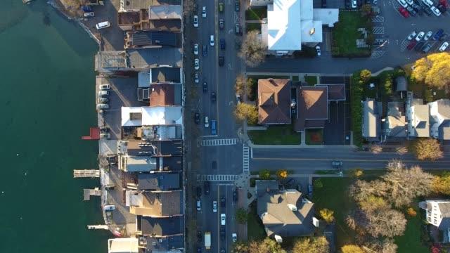 vidéos et rushes de aerial view of main street in small lakeside town in upstate new york - vue en plongée verticale
