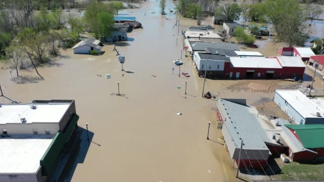 aerial view of main street that is flooded after water from the tittabawassee river breached a nearby dam on may 20, 2020 in sanford, michigan.... - michigan stock videos & royalty-free footage