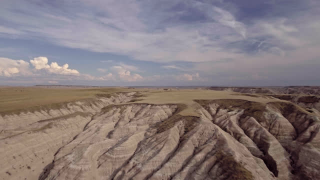 drone. aerial view of majestic badlands canyon rising up to the prehistoric peaks of the rock formations - badlands stock videos & royalty-free footage