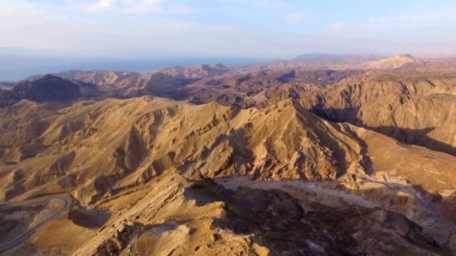 Aerial view of Majestic Eilat Mountains at sunrise with Egypt border in background