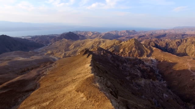 Aerial view of Majestic Eilat Mountains at sunrise with gulf of eilat in background