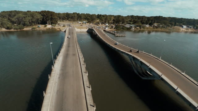stockvideo's en b-roll-footage met aerial view of maldonado bridge between la barra and punta del este, uruguay - uruguay