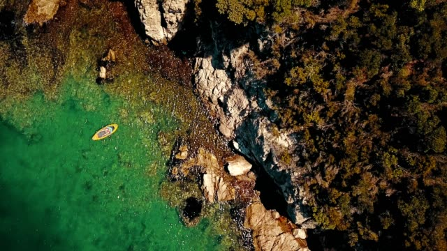 aerial view of man kayaking - greece stock videos & royalty-free footage