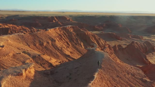 aerial view of man looking at  gobi desert at sunset - independent mongolia stock videos & royalty-free footage