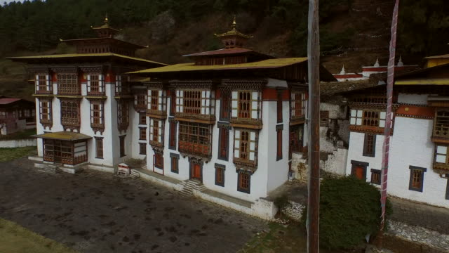 aerial view of manastery with flags - bhutan stock videos & royalty-free footage
