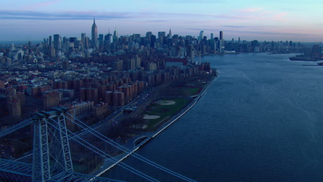 Aerial view of Manhattan along the East River in New York City at dawn.