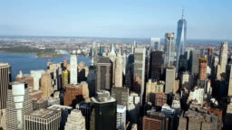 Aerial view of Manhattan downtown with office buindings in New York, America on the shore of East river in sunny day
