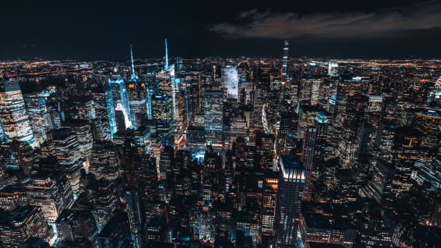 t/l zi aerial view of manhattan skyline at night / nyc - prosperity stock videos & royalty-free footage