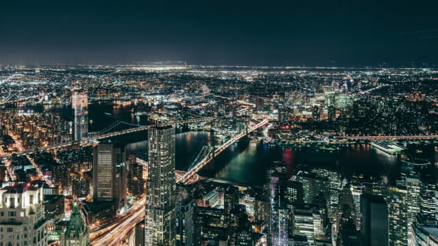 T/L Aerial View of Manhattan Skyline at Night