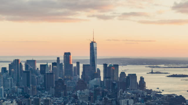 t/l pan aerial view of manhattan skyline at sunset - sunny stock videos & royalty-free footage