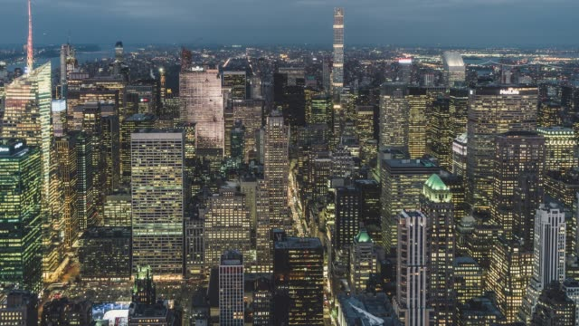t/l ha tu aerial view of manhattan skyline, dusk to night transition / nyc - empire state building stock videos & royalty-free footage
