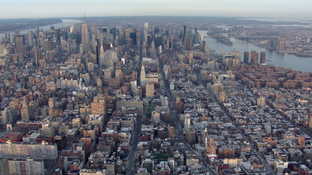 aerial view of manhattan, tilting down over the rooftops of the noho neighborhood. - broadway manhattan stock-videos und b-roll-filmmaterial