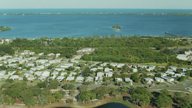 aerial view of manufactured home community on the edge of indian river lagoon in florida - florida us state stock videos & royalty-free footage