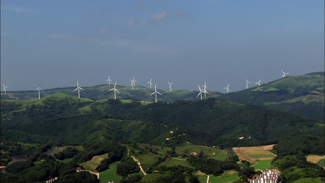 Aerial view of many activating Vertical Axis Wind Turbines on the Daegwallyeong mountian
