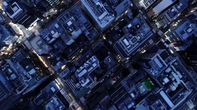 aerial view of many buildings and huge crossroad - 十字路点の映像素材/bロール