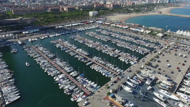aerial view of marina near barceloneta beach - jachthafen stock-videos und b-roll-filmmaterial