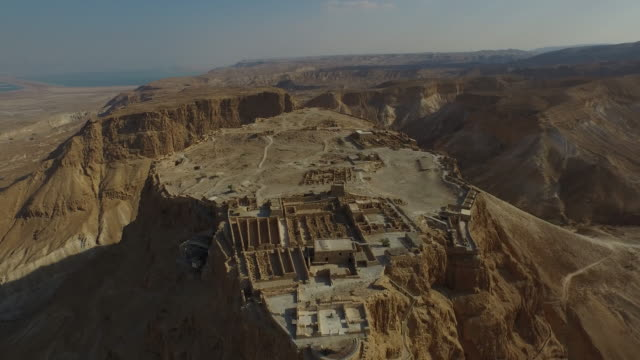 aerial view of masada the ancient site in the judean desert, israel. - dead sea stock videos and b-roll footage