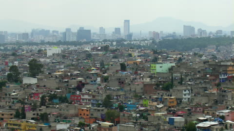 aerial view of mass overpopulation of mexico city. - urban sprawl stock videos & royalty-free footage