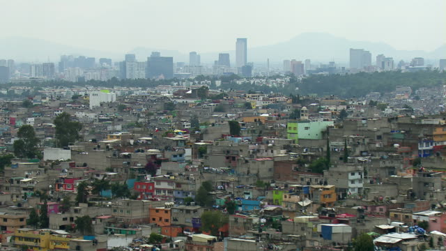 aerial view of mass overpopulation of mexico city. - population explosion stock videos & royalty-free footage