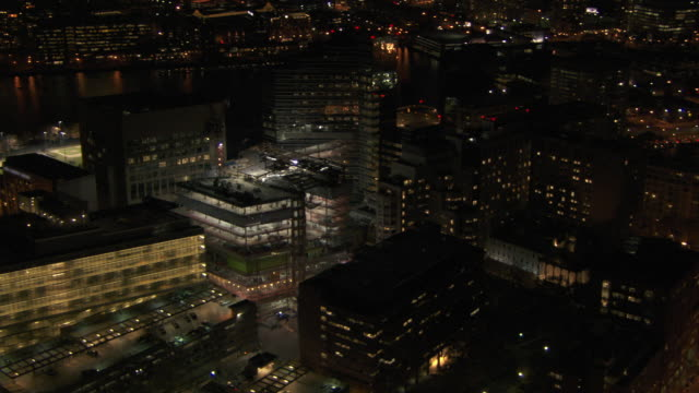 aerial view of massachusetts general hospital with skyscrapers at night in boston, massachusetts, united states of america - massachusetts stock videos & royalty-free footage