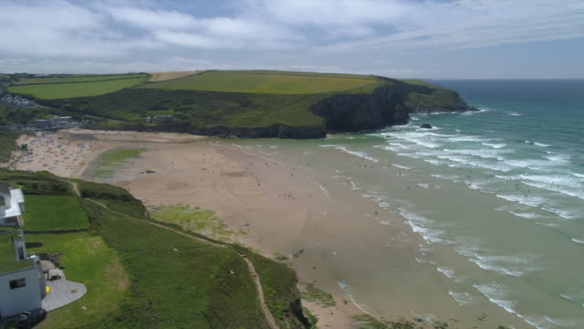 aerial view of mawgan porth and beach - coastal feature stock videos & royalty-free footage