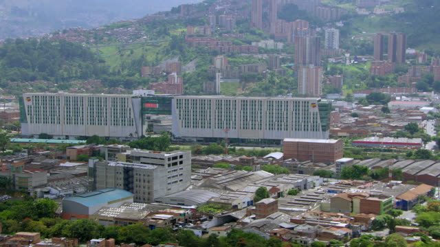 aerial view of medellin, colombia, with bancolombia headquarters. - medellin colombia stock videos & royalty-free footage