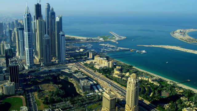 vidéos et rushes de aerial view of media city dubai - bay of water