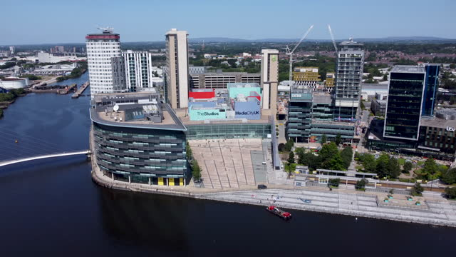 aerial view of media city uk. manchester. tracking shot l to r. - the media stock videos & royalty-free footage