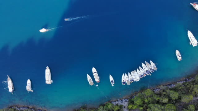 aerial view of mediterranean island seashore with boats - ozgurdonmaz stock videos and b-roll footage